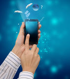 Mobile phone. In the hand Royalty Free Stock Photos