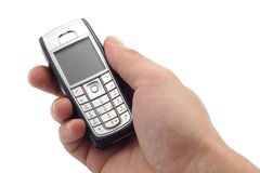 Mobile phone. In hand, isolated on white Royalty Free Stock Images