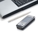 Mobile phone. Pen and laptop on a white background Stock Image