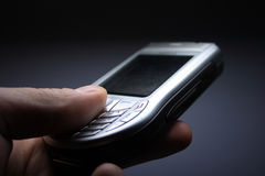 Mobile phone. Close up a mobile phone in a hand royalty free stock photos