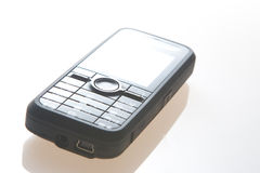Mobile phone. Black mobile phone on white Royalty Free Stock Image