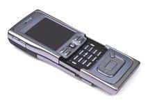 Mobile phone. Shiny mobile phone on white background royalty free stock photo