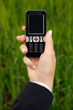 Mobile phone. The hand of the business woman holds a mobile phone Stock Photos