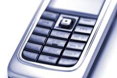 Mobile phone. Generic detail of mobile phone keyboard. Duotone stock photo