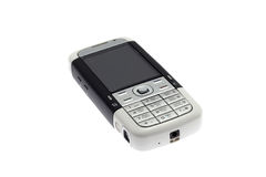 Mobile phone. Laying on a white background Royalty Free Stock Photography