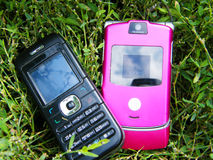 Mobile phone. Pink and black mobile phone on a background of a grass Stock Photography