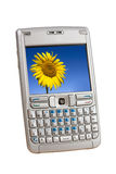 Mobile Phone. Silver mobile phone with a colorful picture on the display isolated on white. Two clipping paths are included for easy extraction, one for the Stock Image