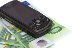 Mobile phone. Mobile phone on the money on a white background Royalty Free Stock Image