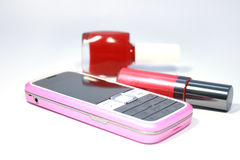 Mobile phone. Womanish  mobile phone and  lipstick and  nail polish Stock Image