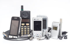 Mobile phone and accessory on white Stock Images