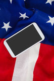 Mobile phone on an American flag Royalty Free Stock Photography