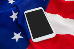Mobile phone on an American flag Royalty Free Stock Images
