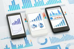 Mobile phone analytics. Mobile Phones With  Analytics Graphs And Charts Stock Photography