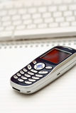 Mobile Phone And Keyboard Stock Images