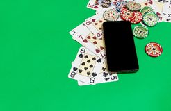 Mobile Phone And Poker Chips With Playing Cards On A Green Table. Online Casino Concept. Royalty Free Stock Photography