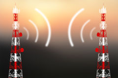 Mobile phone antenna. In orange sunset Stock Photos