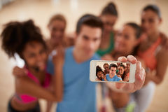 Mobile phone as photo camera in gym, selfie concept Royalty Free Stock Image
