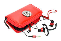 Mobile phone bag and headphones Royalty Free Stock Photos