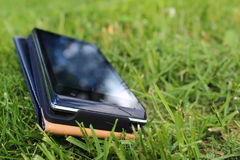 Mobile phone. In the bag lies on the grass Stock Images