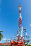 Mobile phone base station tower. Mobile phone base station tower in blue sky Stock Images