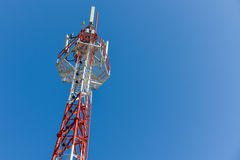 Mobile phone base station tower. Mobile phone base station tower in blue sky Royalty Free Stock Photo