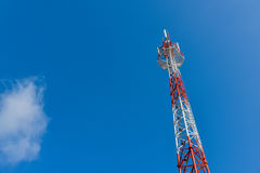 Mobile phone base station tower. Mobile phone base station tower in blue sky Stock Image