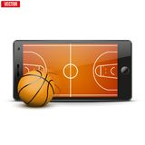 Mobile phone with basketball ball and field on the Stock Images