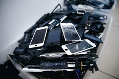 Mobile phone batteries, tablets, broken screens LCD iPhone royalty free stock photography