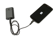 Mobile phone and battery bank Royalty Free Stock Images