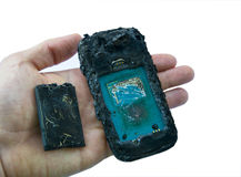 Mobile phone battery explodes and burns due to overheat danger of using smart phone. Royalty Free Stock Image