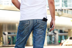 Mobile phone with battery pack in back pocket Royalty Free Stock Photography