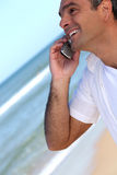 Mobile phone on the beach Royalty Free Stock Images