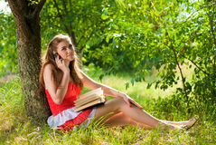 Mobile phone & Beautiful happy smiling woman Royalty Free Stock Photo