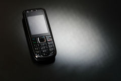 Mobile phone on a black Royalty Free Stock Image