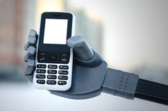 Robotic hand. Mobile phone with blank screen in a robot hand stock image