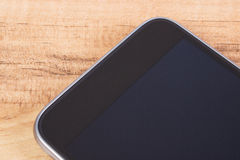 Mobile phone with blank screen on table, smartphone Stock Images
