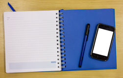 Mobile phone blue diary book Stock Photo