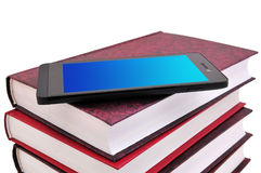 Mobile phone and books Royalty Free Stock Photos