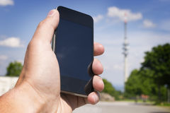Mobile phone and broadcasting tower Royalty Free Stock Photography