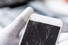 Mobile phone with broken screen Stock Images