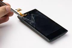 Mobile phone broken screen repair with tool Royalty Free Stock Images