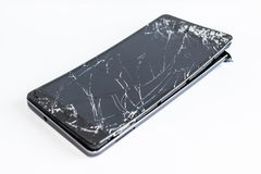 Mobile phone with broken screen. On white background royalty free stock photo
