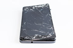 Mobile phone with broken screen. On white background stock image
