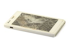 Mobile phone with broken screen, white smartphone.  royalty free stock photos