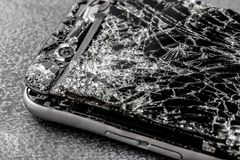 Mobile phone with broken touchscreen on gray background. Mobile phone with broken touchscreen on gray background Repair conzept royalty free stock photo