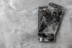 Mobile phone with broken touchscreen on gray background. Mobile phone with broken touchscreen on gray background Repair conzept stock images