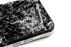 Mobile phone with broken touchscreen on gray background. Mobile phone with broken touchscreen on gray background Repair conzept royalty free stock photography