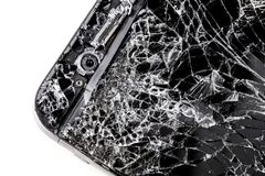 Mobile phone with broken touchscreen on gray background. Mobile phone with broken touchscreen on gray background Repair conzept royalty free stock images