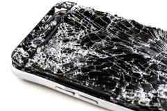 Mobile phone with broken touchscreen on gray background. Mobile phone with broken touchscreen on gray background Repair conzept royalty free stock photos