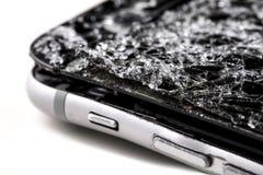 Mobile phone with broken touchscreen on gray background. Mobile phone with broken touchscreen on gray background Repair conzept stock photos